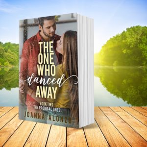 The One Who Danced Away paperback on boardwalk in front o flake